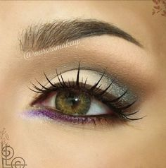 Terracota eyeshadow with a brown upper lid liner and purple eyeliner on the bottom lid.