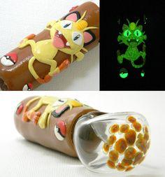 Glow in the dark Pokemon Meowth spoon pipe. Made by DeMatteo Art.