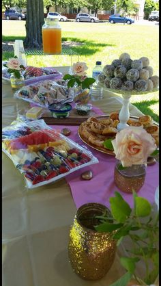 Bridal shower afternoon tea spread. Cherry ripe balls, white fruchoc balls, pizza pinwheels, sandwiches, antipasto skewers, cheese and fruit platters, cake pops, lemon shortbread. All home made!