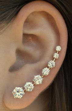 earrings: multiple stacked earrings and ear cuffs  diamonds