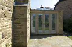 Stunning stone makes this orangery the perfect addition
