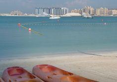 A quiet beach in Dubai looking at the Palm