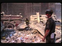 9/11/2001 - Silent film of the Towers collapsing, & many pictures of First Responders working among the devastation, while trying to contain their feelings. (9 minutes)