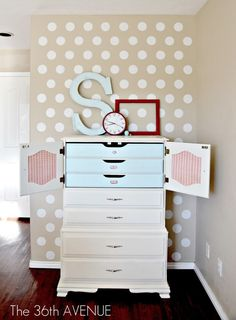 How cute is this?! This DIY furniture re-do also provides great storage. Love the polka-dots on the wall! | The 36th Avenue