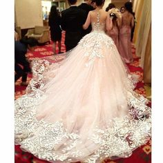 Amazing Fairytale Wedding Gown in Pink Peach Tint embed with Floral Details lace (offwhite) just fabulous #fairytale #weddinggown #Bridal #Bride #Fashion #Lace #pink #peach #tint #floraldetails #Style #wedding #back #gorgeous #offwhite #fabulous #elegance