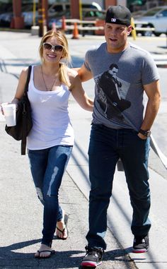 Their fingers interlaced, Hilary sneaks an adoring look at her then-boyfriend as they stroll in Manhattan around the time they first started dating in August of 2007. Comrie was playing for the New York Islanders at the time.