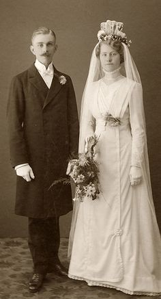 """Bride and groom; """"what a top piece on her veil""""."""