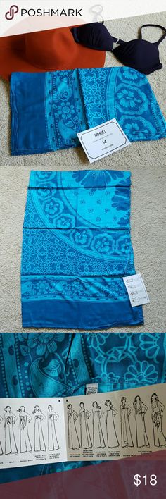 "NWT Blue Pareo Blue pareo in a Hawaiian/hibiscus design. Never used. Can be worn 14 different ways - comes with instruction card.  Measures 66.5"" long by 21.5"" wide.  Smoke- and pet-free home. Other Sarongs"