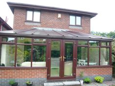A handsome brick conservatory in Bolton in need of much-improved roof insulation!
