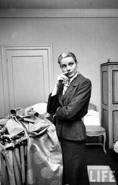 Actress Grace Kelly packing clothing in New York prior to her wedding to Prince Rainier.  Photo by Lisa Larsen.  March 1956.