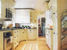 mary engelbreit's kitchen. it's the only room in her house that i really like. and i'm an ME fan.