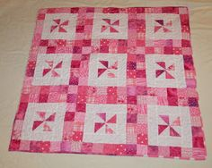 """A handful of half square triangle units give this easy baby quilt a lot of pop!     For a 36"""" square quilt, you'll need:    36 - print half..."""