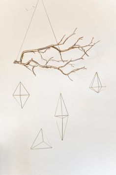 Gold geometric, himmeli shapes hanging on a gold branch. Branch is 20 long and s… Gold geometric, himmeli shapes hanging on a gold branch. Branch is 20 long and shapes are long.