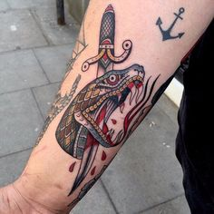 Arm Stabbed Snake New School Tattoo