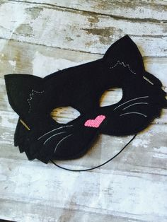 This is a super fun black cat felt mask for play, dress up, and Halloween for kids of all ages! Mask is approximately 4.5 tall and 7 wide. Elastic is 12 long. If youd like Im happy to make this kitty cat in other colors, too! How about white, grey, ginger, or cream? Meow!! Find more amazing felt mask designs by shopping at www.babymoon.etsy.com in the Felt Toys for Busy Hands Section