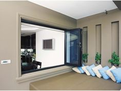 Stegbar Aluminium bi-fold window promises a lifetime of reliability, perfect for providing access between kitchens and patios or unobstructed panoramic views Kitchen Containers, House Design, House, Aluminium Windows, Windows, Living Spaces, Home Decor, Lounge Room, Window Frames