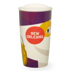 A double-walled, ceramic travel mug with a design showcasing New Orleans as the vibrant musical epicenter it is, part of the Starbucks Dot Local Collection.