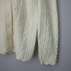 Vintage cable knit cardigan Adorable Sears Roebuck and Co. Sweater. Excellent vintage condition! Off White in color. Perfect this spring with a sundress.   Bundle for best deals! Hundreds of items available for discounted bundles! You can get lots of items for a low price and one shipping fee!  Follow on IG: @the.junk.drawer Vintage Sweaters Cardigans