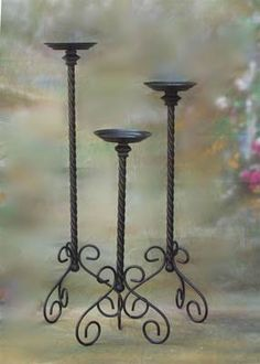 Wrought iron candle stands for country charm to warm up contemporary furniture. Rod Iron Decor, Wrought Iron Decor, Wrought Iron Gates, Floor Candle Holders, Wrought Iron Candle Holders, Candle Stands, Iron Furniture, Wood Home Decor, Mosaic Garden