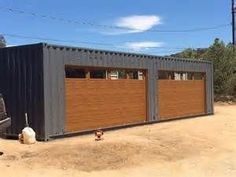 Container House - Shipping Container Garage Door industrial-garage-and-shed Who Else Wants Simple Step-By-Step Plans To Design And Build A Container Home From Scratch? Container Home Designs, Container Shop, Cargo Container, Container Cabin, Prefab Shipping Container Homes, Shipping Container Buildings, Shipping Containers, Shipping Container Workshop, Sea Containers