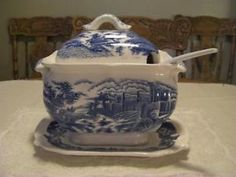 "This stunning handpainted pc is in great condition! This blue & white tureen is marked stating that it is hand decorated in Japan~made by Elbro! Holds stews, soups etc! Includes a peaked lid, setting plate, laddle, & the tureen! The laddle is an added pc~originally      not with the set. Size:Tureen~Height: 10 1/2"" by Width 6 3/4"" by Depth 5""  Plate: 10 3/4"" by 7 1/2"". Minor age wear, 2 tiny chips on inside lip~not noticeable (pic #6 on Kijiji)! Click on this pic 2X & it'll take you to…"