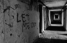 Let me out written on the wall at the abandoned Napsbury mental asylum hospital. That could have been graffitied after the place was already abandoned, but what I love about this photo is the light/shadow thing going on, making for a hypnotic image. Abandoned Asylums, Abandoned Buildings, Abandoned Places, Mental Asylum, Insane Asylum, Scary, Creepy, Abandoned Hospital, Haunted Places