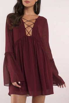 Born free in the Wine Addy Lace Up Shift Dress. You'll feel super light, sexy, and free in this layered long sleeve dress featuring lace up front and Black Dress With Sleeves, Dresses With Sleeves, Smock Dress, Lace Dress, Long Sheer Dress, Sorority Recruitment Outfits, Short Frocks, Over 50 Womens Fashion, Pretty Dresses