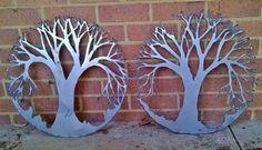Plasma cut Trees of Life.