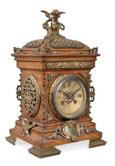 A French gilt brass mounted oak mantel clock. 8/30, 5am