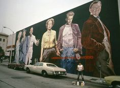 Eloy Torrez 1600 N Hudson Ave., Los Angeles, CA 90028.  Portraits (from left to right) of Marilyn Monroe, Humphrey Bogart, Fred Astaire, Bette Davis, James Dean, and Clark Gable.The mural was destroyed in the 1994 Northridge earthquake. The Mural Conservancy and the Hollywood Arts Council have assisted Torrez in retrieving fragments of the mural and sponsoring a new version of it in a new location in Hollywood.