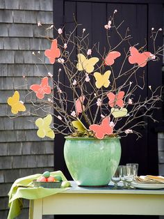 To make this pretty Easter Butterfly Tree, hang paper butterflies on branches with twine. More info:  http://www.bhg.com/holidays/easter/decorating/quick-and-easy-easter-decorations/#page=11