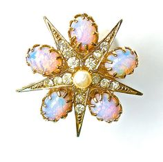 Stellar vintage Star brooch Victorian style with pink fire opal glass dragon breath. Great condition.  $23.00