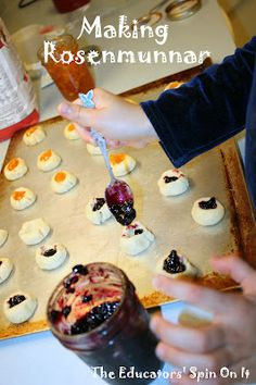 Rosenmunnar  - a Swedish thumbprint cookie.  If you are looking for an easy, hands on kids cookie - this is it! The kids can help measure, roll the balls, press the thumbprints, and fill the jam.  We're learning about the world with Around the World In 12 Dishes.