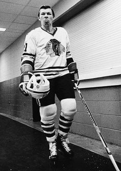 Stan Mikita sticks his tongue out as he walks out to play in the Chicago Blackhawks game against the New York Islanders on Dec. 1974 at the Nassau Coliseum in Uniondale, N. Ice Hockey Players, Nhl Players, Team Player, Chicago Blackhawks, Hockey Pictures, Sports Pictures, Bruce Bennett, Sports Personality, Hockey Players