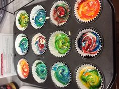 Use white cake batter and put food coloring in each individual cupcake. Swirl them with a knife and you will get the tie dye effect