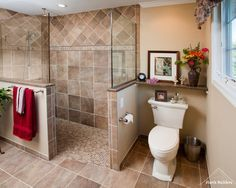 """The shower is 3"" wide and 7'-6"" long, with a 36"" doorway."" Half wall for towel bar and commode privacy. Good use of granite on top of half walls."