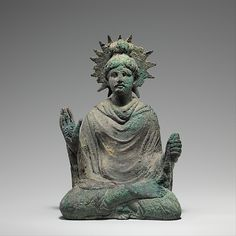 This small bronze Buddha is probably one of the earliest iconic representations of Shakyamuni from Gandhara. He sits in a yogic posture holding his right hand in abhaya mudra (a gesture of approachability); his unusual halo has serrations that indicate radiating light. Seated Buddha  Date:1st to mid-2nd century Culture:Pakistan (ancient region of Gandhara) Medium:Bronze with traces of gold leaf Dimensions:H. 6 5/8 in. (16.8 cm); W. 4 1/2 in. (11.4 cm); D. 4 in. (10.2 cm)…