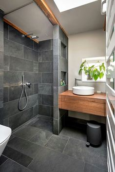 A little bathroom in Berlin. Some wood, some grey, some green. By conscious-design.de