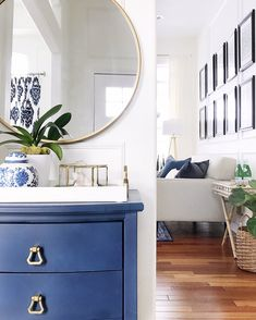 Entryway and living room ideas - blue cabinet and round mirror with botanical gallery wall, bamboo bar cart and modern furniture - how to choose a design style - jane at home Blue Wall Mirrors, Picture Frame Molding, Blue Cabinets, Kitchen Cabinets, Spring Home Decor, Declutter Your Home, Interior Exterior, Interior Design, Room Interior
