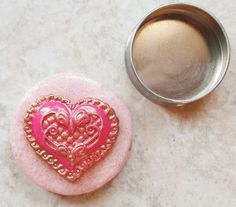 Bead Tin       This tin was a Burt's Bees lip balm tin.  These are wonderful little tins for storing seed beads.  Nothing can be plain-jane, so I prettied it up with some polymer clay.  The paint was removed from the bottom of the tin, using a Dremel.