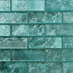 9055 Juniper  Folia Glass is inspired by the seasonal change in foliage. Each individually mesh-mounted tile evokes the raw veining of leaf patterns with vivid decorative streaks against solid metallic colors.  Color: Blue