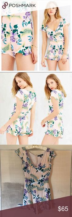 """FL&L floral romper🌸🍋 For Love and Lemons floral romper. Light pink with a botanic pattern🌸🌿 Pre-loved but still in great condition. Some gathering with wear but still has so much life left! It's hard for me to give up this beautiful piece!! Sized an XS, fits true to size. Bust-14"""" Length-29"""" Waist-12"""" For Love and Lemons Dresses Mini"""