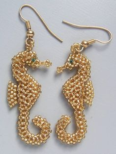 Seahorse earrings made with petite seed beads. Pattern from Bead-patterns.com Designer Ruth Kiel