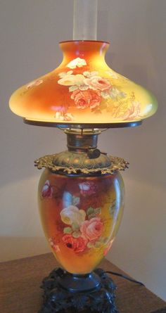 I want this to still be Kerosene. I wonder if you can convert it back. KP Victorian Roses Gone With the Wind Banquet Oil Kerosene Lamp Converted To Electric Antique Hurricane - Found on Ruby Lane Antique Hurricane Lamps, Hurricane Oil Lamps, Antique Oil Lamps, Old Lamps, Vintage Lamps, Victorian Lighting, Victorian Lamps, Antique Lighting, Galle Vase