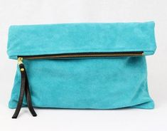 This clutch can hold so much more than an average clutch and the color is perfect with an all black outfit.