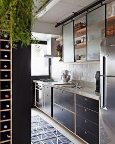 This kitchen keeps it light with opaque glass sliding cabinet doors. This kitchen keeps it light with opaque glass sliding cabinet doors. Rustic Kitchen Design, Interior Design Kitchen, Kitchen Industrial, Kitchen Designs, Kitchen Furniture, Kitchen Decor, Glass Kitchen, Kitchen Storage, Office Furniture