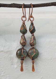 Green Opal earrings These handmade wire earrings have an earthy tribal inspired look thats perfect for fall. They were made with oxidized copper wire and African Green Opal beads. One of a kind and bohemian chic! * Measurements: Approx. 3/4 x 2 1/4 long * Made with genuine copper