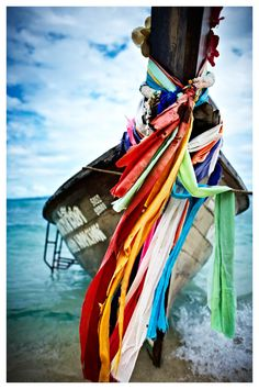 Came across this boat on our beach walk. Look at those vivid, intriguing cloths tied onto the tip. I close my eyes and make a wish for each one. #KiwiBeMine @Kiwi Collection