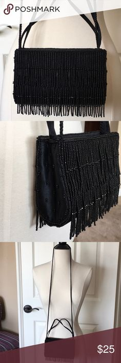 "Black beaded flapper style crossbody arm bag purse Like New doesn't look like its ever been used. Darling black purse in perfect condition. You can wear two ways, crossbody style or tuck in strap and hold on your arm. Either way straps that are not being used can be tucked in. Approx. length 6.5"" x height 5"" x 2"" width La Regale Bags Crossbody Bags"