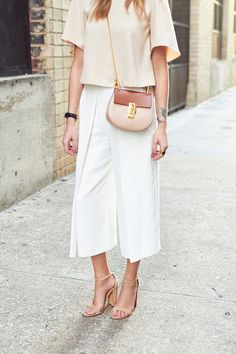 white-out, cropped outfit with tan cross-body bag and nude heels